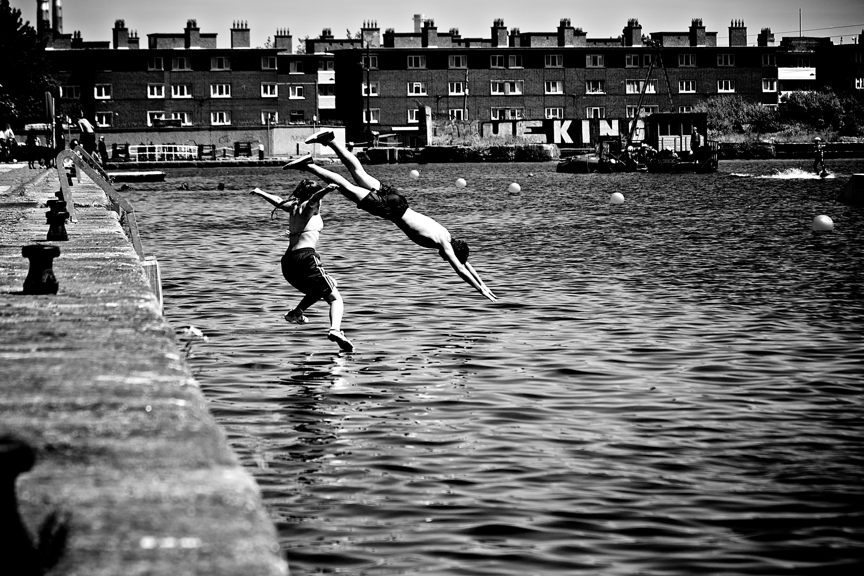Swimmers diving into a lake- represents me diving in to the new archives blog project