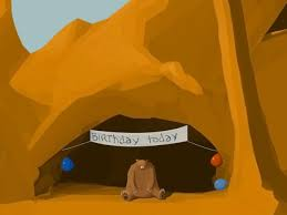 A bear alone in a cave with a birthday banner and balloons